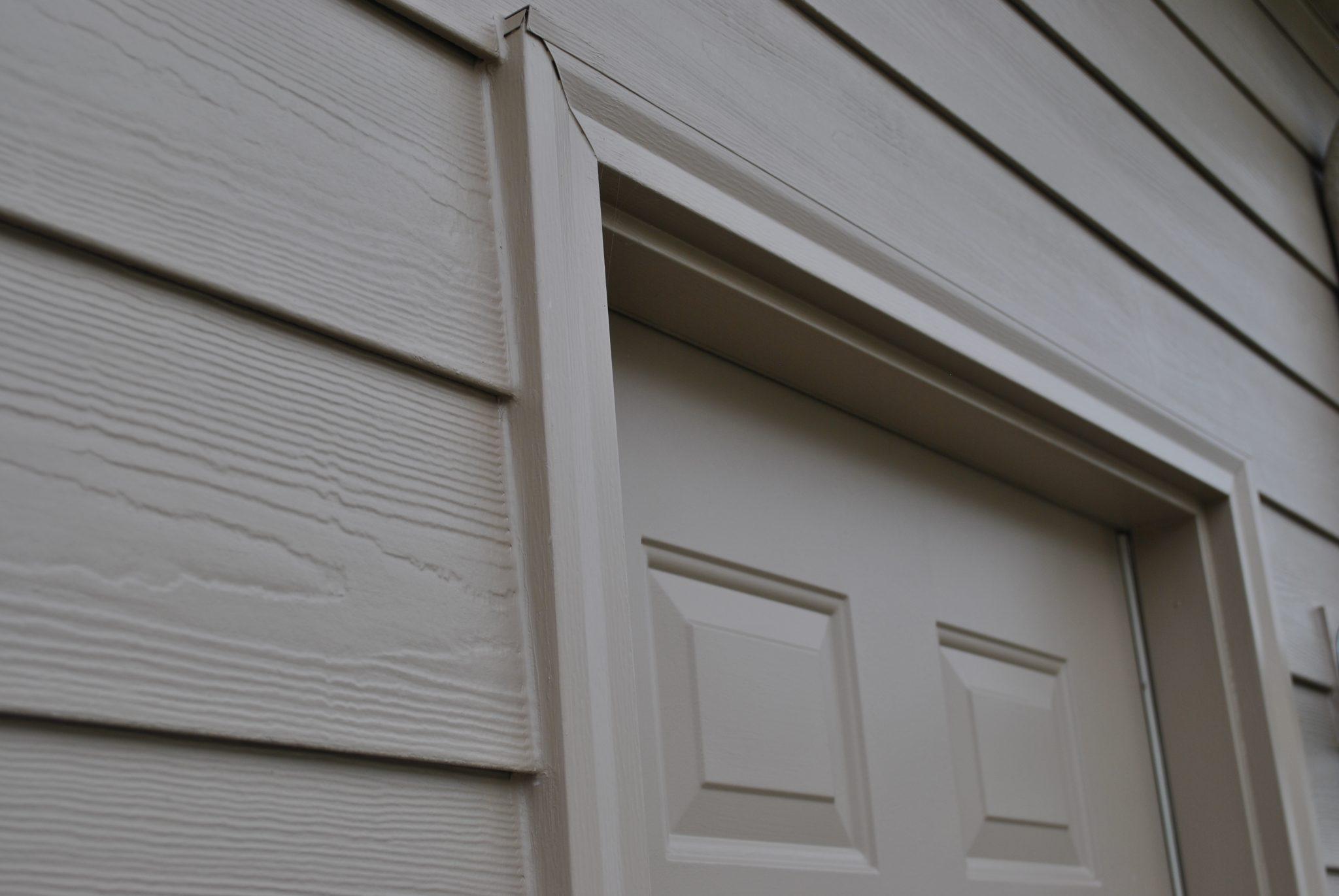 vinyl siding vs. fiber cement siding installed on this home in Lincoln